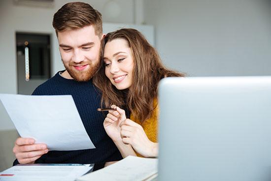 a couple preparing a budget