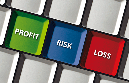 keyboard with the words profit, loss, risk