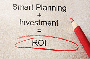 writing on paper smart planning plus investment equals return on investment